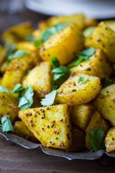 Bombay Potatoes: Crispy on the outside, fluffy on the inside, and richly spiced with Indian flavors -- Bombay Potatoes are the perfect side dish for any Indian meal!