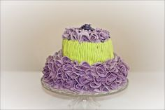 Chic  and classy birthday cake, with lilac ruffles and roses