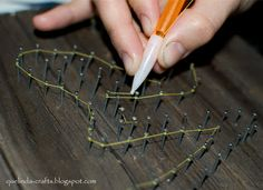 Make string art easier with a click pen/mechanical pencil.  When it comes to doing the thread, make it easy on yourself and snag a clicky pen.   Pull it apart and thread your string through the hollow tube.  This is going to make it so so so much easier to wrap the thread around all of the nails and gives you great control.  The original tutorial sacrifices a mechanical pencil and does the same thing (but since mechanical pencil m