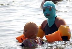 One for me, one for you: Small sized protective head masks are also made for children in china face-kini
