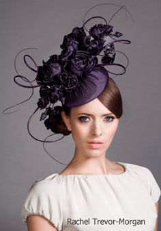 I love Purple.  I love Hats.  This embodies two things that I absolutely love.. . . .and I would LOVE to wear this hat!