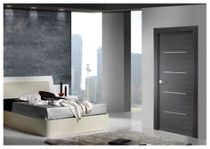 Ash grey #contemporarydoor with aluminium coloured inserts. From JB Kind's bespoke options.