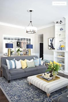 Elegant Spring decorating using pretty blue and vibrant yellow accents along with real and faux florals to help bring a sophisticated yet relaxed feel to your home. Living Room Color Schemes, Living Room Accents, Living Room Grey, Home Living Room, Living Room Designs, Apartment Living, Living Area, White Room Decor, Yellow Home Decor