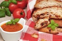 Sourdough Tomato Basil Garlic Bread slices with dipping sauce