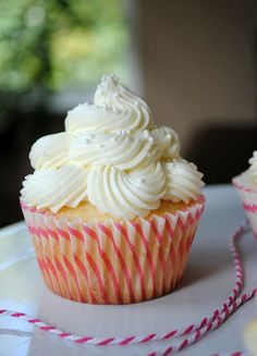 Almond Wedding Cake Cupcakes with Raspberry Filling #desserts #dessertrecipes #yummy #delicious #food #sweet
