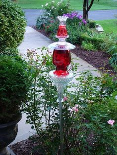 #Garden #art #totem made from a collection of glass items - stunning!!