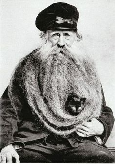 strange . . . note the cat half hidden in his beard
