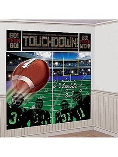 """Score big with this Football Field Scene Setter! This football decoration is a set of vinyl posters depicting a football field, a large football soaring overhead, and a huddle of players, plus a """"TOUC"""