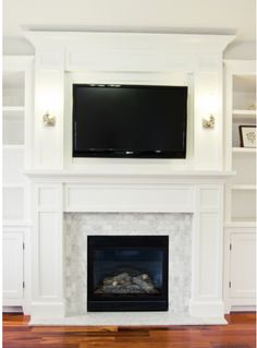 Millwork on fireplace. Great design with TV above fireplace.