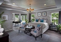 I like the gray walls with the dark furniture and teal accents