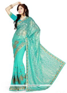 Make the heads flip whenever you costume up in this desirable turquoise brasso georgette designer saree. This attractive attire is displaying some incredible embroidery done with embroidered and patch...