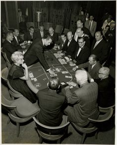 Photograph of baccarat players, Sands Hotel and Casino, Las Vegas, circa late 1950s-early 1960s. John Scarne casino manager Carl Cohen at right.