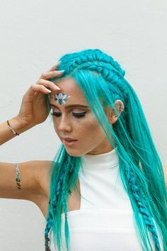 Beautiful teal blue hair with braids and fairy like freckles