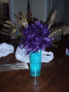 Need help(wedding decorations/table decor) :  wedding budget wedding centerpieces turquoise and black wedding wedding table decorations using feathers as accents in center pieces and deor would be very nice...Feather Centerpiece wedding centerpiece peacock 111111 1 evening wedding purple led diy diy centerpiece blue navy bouquet inspiration ceremony reception Feather Centerpiece