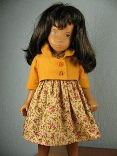 Pale yellow based floral dress with a brighter yellow short sleeved jacket (matching pants) by Jadzia Doll Patterns, Sewing Patterns, Sasha Doll, Doll Outfits, Yellow Shorts, Smock Dress, 18 Inch Doll, American Girl, Doll Clothes