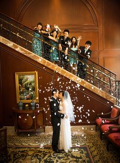Get your whole wedding party in on the fun. I am loving this shot from the stairwell and how cute are the bride and groom?! Photo | SnapKnot | See more confetti wedding details here: http://www.mywedding.com/articles/confetti-wedding-details/