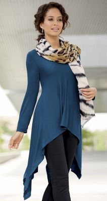 Flowy tunic with handkerchief hem is instant coverage (and reveal), elegant accent and romantic flattery. Rayon/spandex; machine wash. Made in USA and imported.