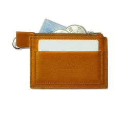 6f2755d1fd7 An elegant zip purse wallet made using vegetable-tanned Tuscan Vacchetta  leather in tan