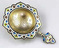 A fine Norwegian enamel tea strainer by Norsk Filigransfabrikk of Oslo, Norway