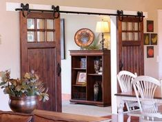 Barn Door : love the U shaped pully, the rod mounted on the white contrasting the dark colored door and the window opening in the door (stable doors)
