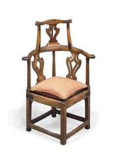 A George III provincial elm corner armchair.