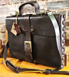 Cowhide Leather Briefcase  by Sandast on Scoutmob Shoppe. A rugged briefcase made with distressed leather for a naturally aged look.