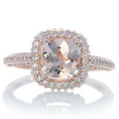 14 Karat Rose Gold Cushion Cut Morganite Diamond Halo Engagement Wedding Anniversary Ring. $1,800.00, via Etsy.