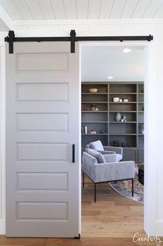 Bookshelves painted in SW Porpoise. Millhaven Homes Painted Bookshelves, Sala Grande, Barn Door Designs, Utah, Garage Makeover, Upstairs Bathrooms, Mansions Homes, Parade Of Homes, Bathroom Colors