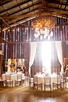 This is pretty much my dream wedding right here. The rustic look, with lights, wood chairs, wild flowers in jars. Simple, elegant. Yes!