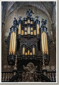 Dark, ominous-looking organ in St. Salvator's Cathedral, Bruges, Belgium. It was built originally in 1717, and was rebuilt and expanded 3 times in the 20th century. Even the backdrop of this stone church is dreary.