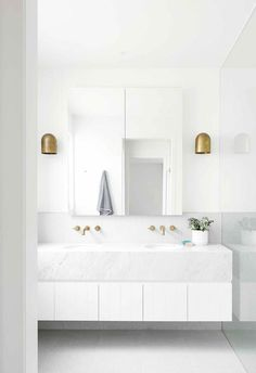 White bathrooms with tone-on-tone design are a classic look that never goes out of style. Creating a white bathroom means coordinating bathroom fixtures and tile. Modern White Bathroom, Minimalist Bathroom, Small Bathroom, Bathroom Ideas, Master Bathroom, Classic Bathroom, Bathroom Plants, Bathroom Designs, Bathroom Organization