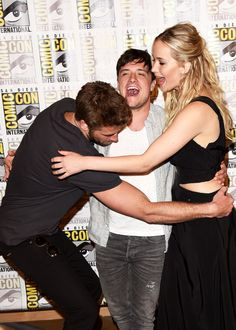 Liam Hemsworth, Josh Hutcherson and Jennifer Lawrence of 'The Hunger Games: Mockingjay - Part 2' attends the Lionsgate press room during Comic-Con International 2015 at the Hilton Bayfront on July 9, 2015 in San Diego, California.