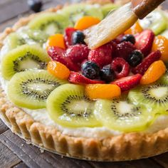 Learn how to make homemade fresh fruit tart with buttery pastry crust and mascarpone cream filling!