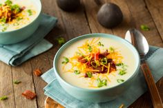 This healthier German Potato Soup features creamy nonfat yogurt, a host of fresh veggies, an authentic blend of spices and is topped with turkey bacon. German Potato Soup, Loaded Baked Potato Soup, Cheddar, How To Make Potatoes, Cream Of Celery Soup, Leftover Mashed Potatoes, Soup And Salad, Soup Recipes, Stuffed Peppers
