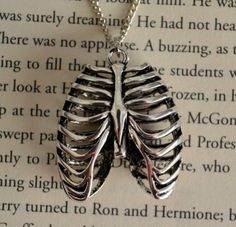 Rib cage necklace. More importantly, it's sitting on a Harry Potter book. And I'm pretty sure it's The Chamber of Secrets. Just saying.