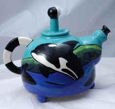 Hand Painted Orca Design Ceramic Pottery Tea Pot with a fanciful handle and extra long finial knob. It was a creation by Suzanne Ball of Wild Things Pottery of Bellingham Washington. Susanne Ball now...