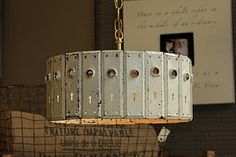 Repurpose...beautifully!  Light fixture from vintage door plates by Nashville artist Robbie Cook.  GORGEOUS!