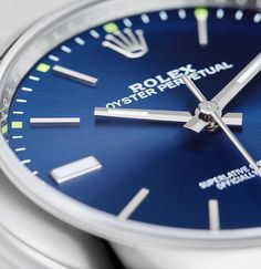 The intense blue dial of the Rolex Oyster Perpetual 39, with 18ct white gold hour markers enhanced by green accents.