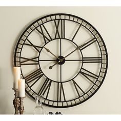 Large metal clock with simple design.