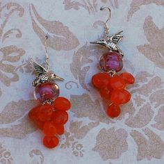 Carnelian Hummingbird Statement Earrings. Gemstone and Boro Lampwork Bead With Sterling Silver. Magnolia Jewel Designs, $68.00.