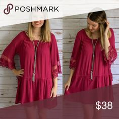 """Burgundy Dress We are loving this new burgundy dress! It features lace on the sleeves which are 3/4 in length, a flowy fit, and a drawstring waist.  Model is 5'9"""" and wearing a small.  Drawstring waist is not tightened in these photos Dresses Midi"""