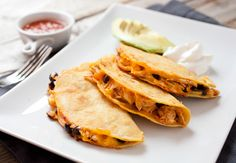 Shredded Chicken Hard Tacos! These crispy and cheesy tacos are half quesadilla and half hard taco. The filling is easy to make and you can use almost anything in the fridge! Once you try them you'll never go back to regular tacos! | www.macheesmo.com