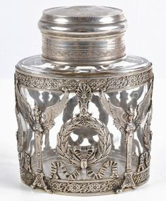 A German silver coloured mounted oval cut glass jar.