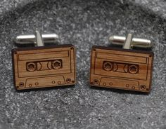 Wooden #cufflinks with a custom cassette illustration etched onto the surface. These unique cufflinks are also an antique, coming from a reclaimed copper beech tree in Chartwell England that was once on Sir Winston Churchill's property and is over 200 years old! 100% Beech #Wood. - http://thegadgetflow.com/portfolio/wooden-cassette-cufflinks/