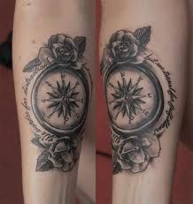 compass tattoo with a frame around it