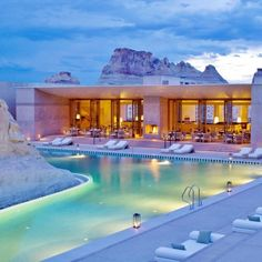 Deep in the desert canyons of Utah, Amangiri is a luxe resort that embraces the surrounding environment with a pool that's ingeniously built around a large, natural rock formation. Swimmers can float around the main Pavilion Romantic Vacations, Romantic Getaways, Dream Vacations, Romantic Destinations, Romantic Travel, Vacation Destinations, Vacation Spots, Greece Vacation, The Places Youll Go