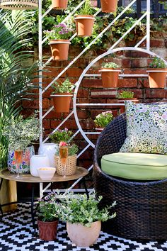 Boho garden pergola in green and pink with gold accents and white West Elm plant stand