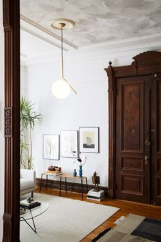 An IC Pendant Light—the one Dixon likened to having the sun in his living room—is by Michael Anastassiades for FLOS. Living Room Inspiration, Interior Inspiration, Living Room Lighting, Living Room Decor, Office Lighting, Lighting Ideas, Lighting Design, Living Rooms, Interior Design Minimalist