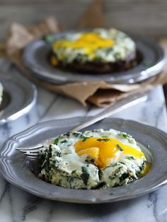 Portobello Mushroom Egg Bakes by runningtothekitchen: These portobello mushrooms are stuffed with a ricotta spinach mixture and finished with a runny egg that's baked right on top. They're a perfect quick dinner or savory breakfast. #Portobello #Egg