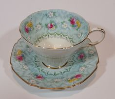 1930s Paragon Evangeline Aqua Blue Pattern Teacup and Saucer https://treasurevalleyantiques.com/products/1930s-paragon-evangeline-aqua-blue-pattern-teacup-and-saucer #Rare #Antiques #TeaTime #England #Paragon #Flowers #Floral #Pretty #HerMajesty #Royalty #Luxury #FineChina #TeaWare #Porcelain #Handpainted #Shopping #OnlineStores #Abbotsford #BritishColumbia